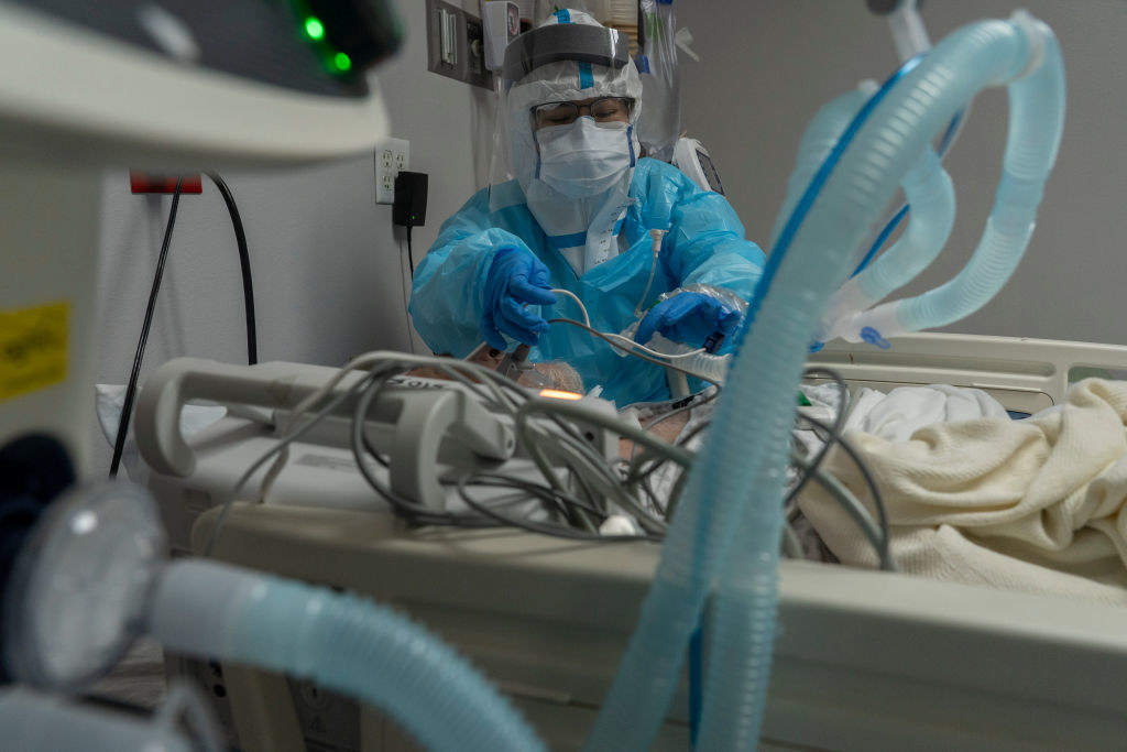 A medical staff putting a ventilator on a patient
