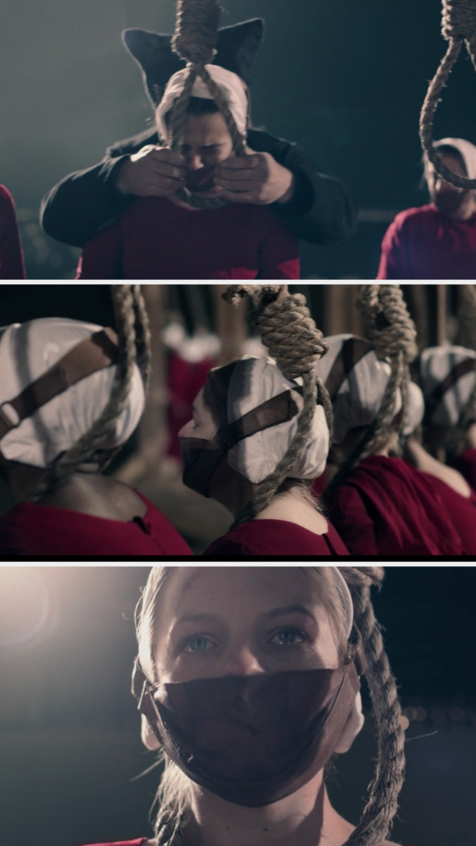 the handmaids' heads are in put in nooses as they cry with masks on