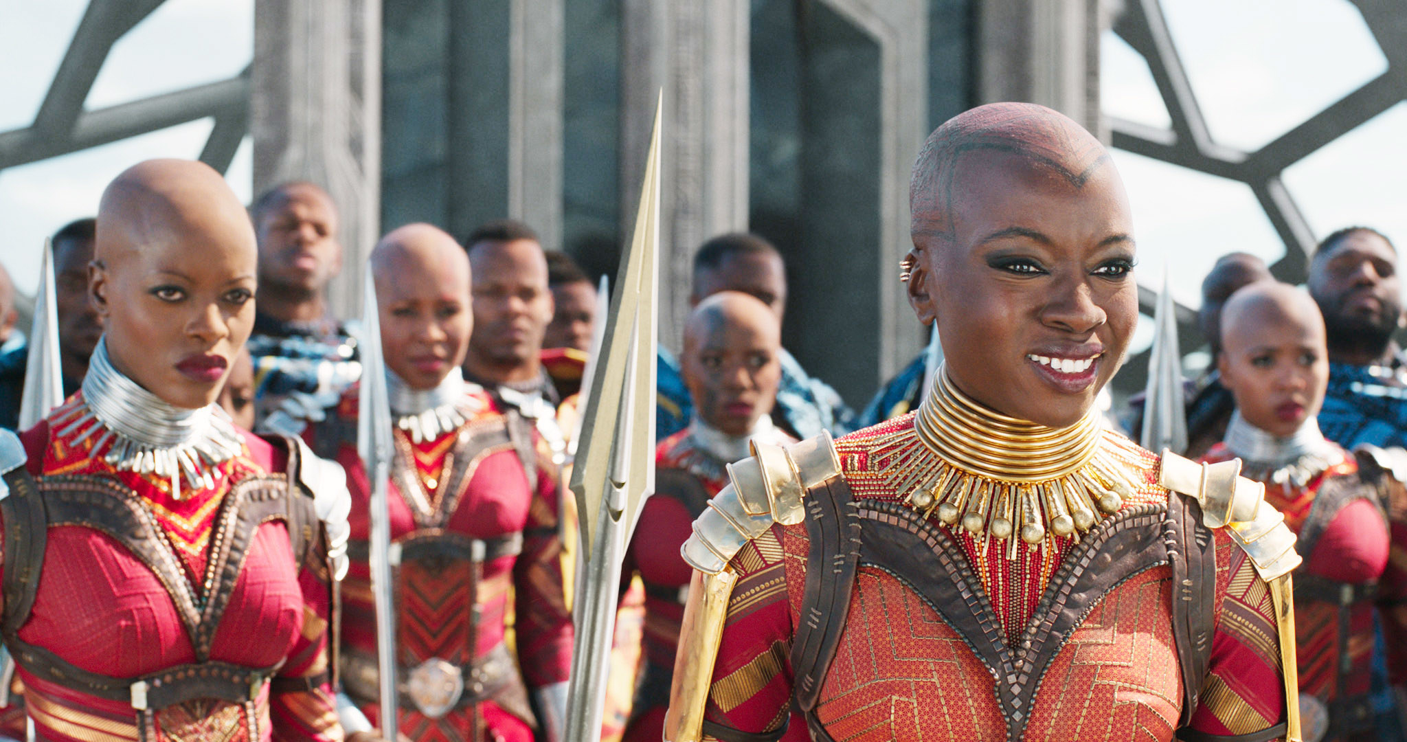 Okoye smiling as she stands in front of other members of the Dora Milaje