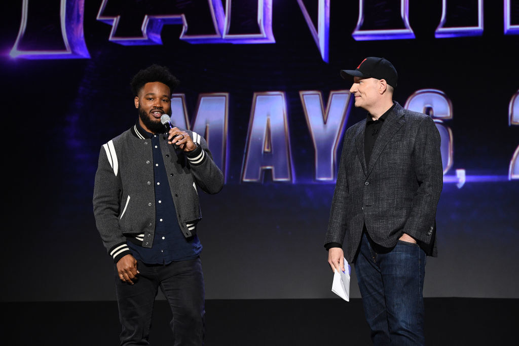Ryan Coogler standing on stage with Kevin Feige