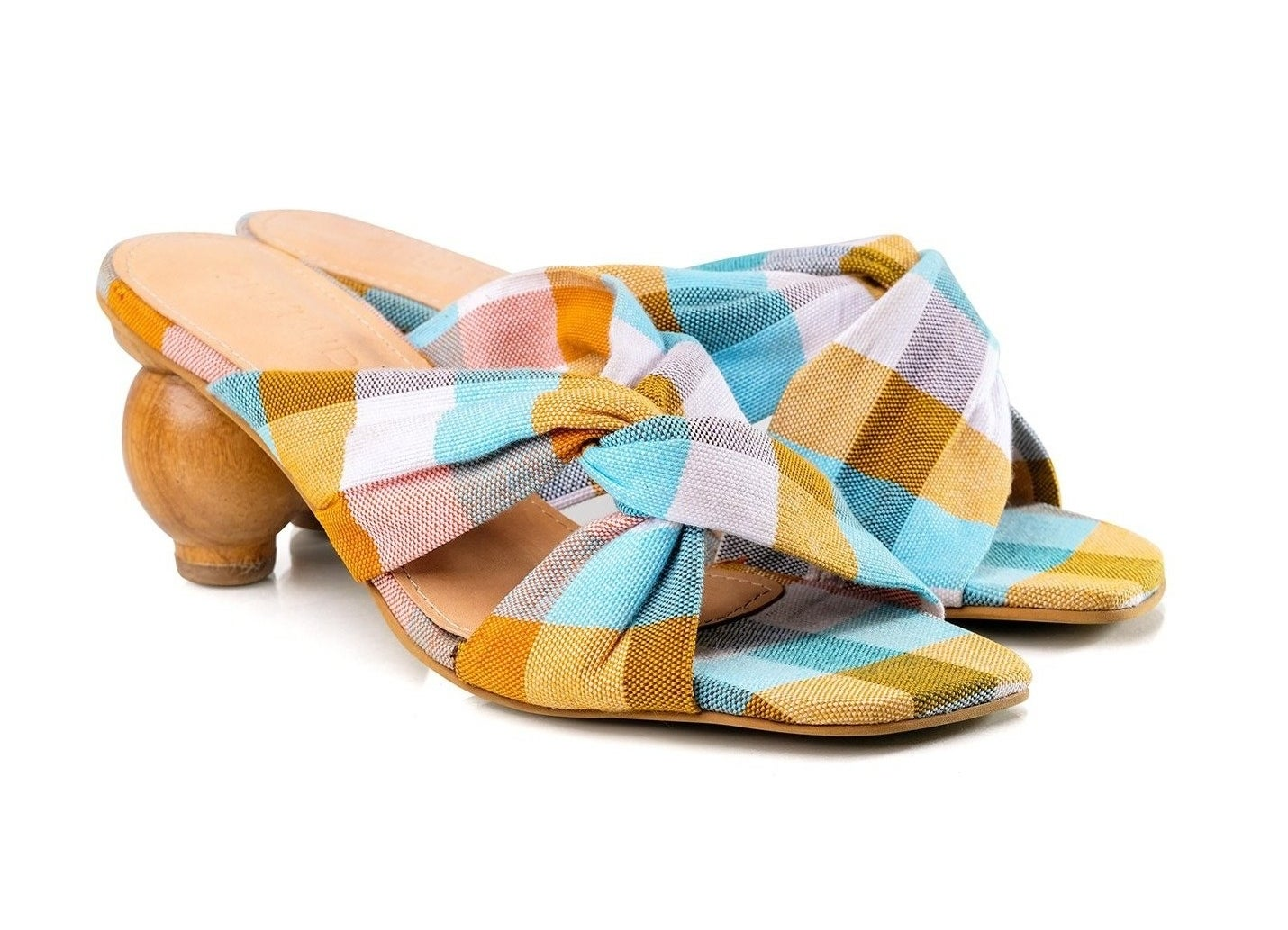 the mules with circular heel and yellow, blue, and white plaid cross-top mules