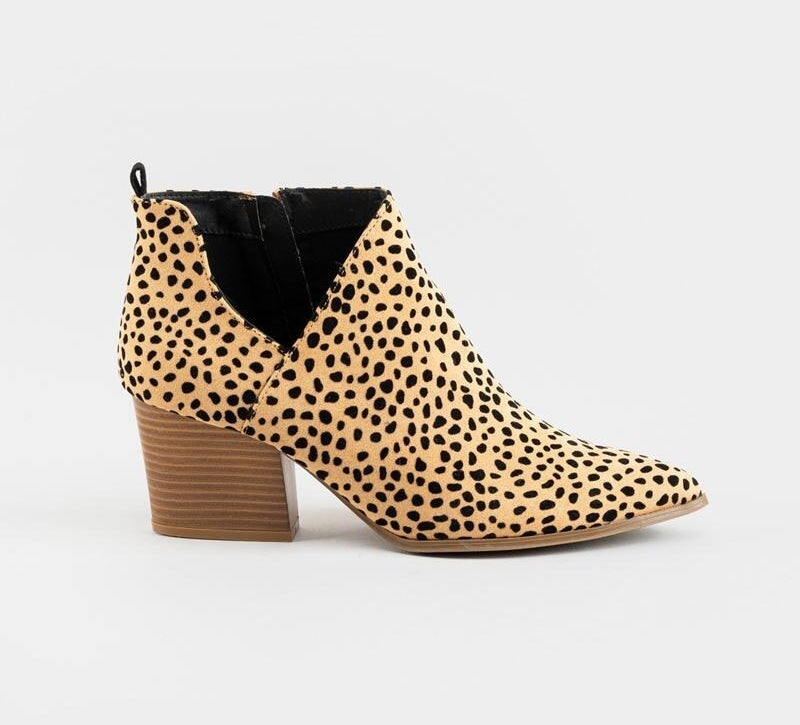 a cheetah print bootie with a chunky wooden heel