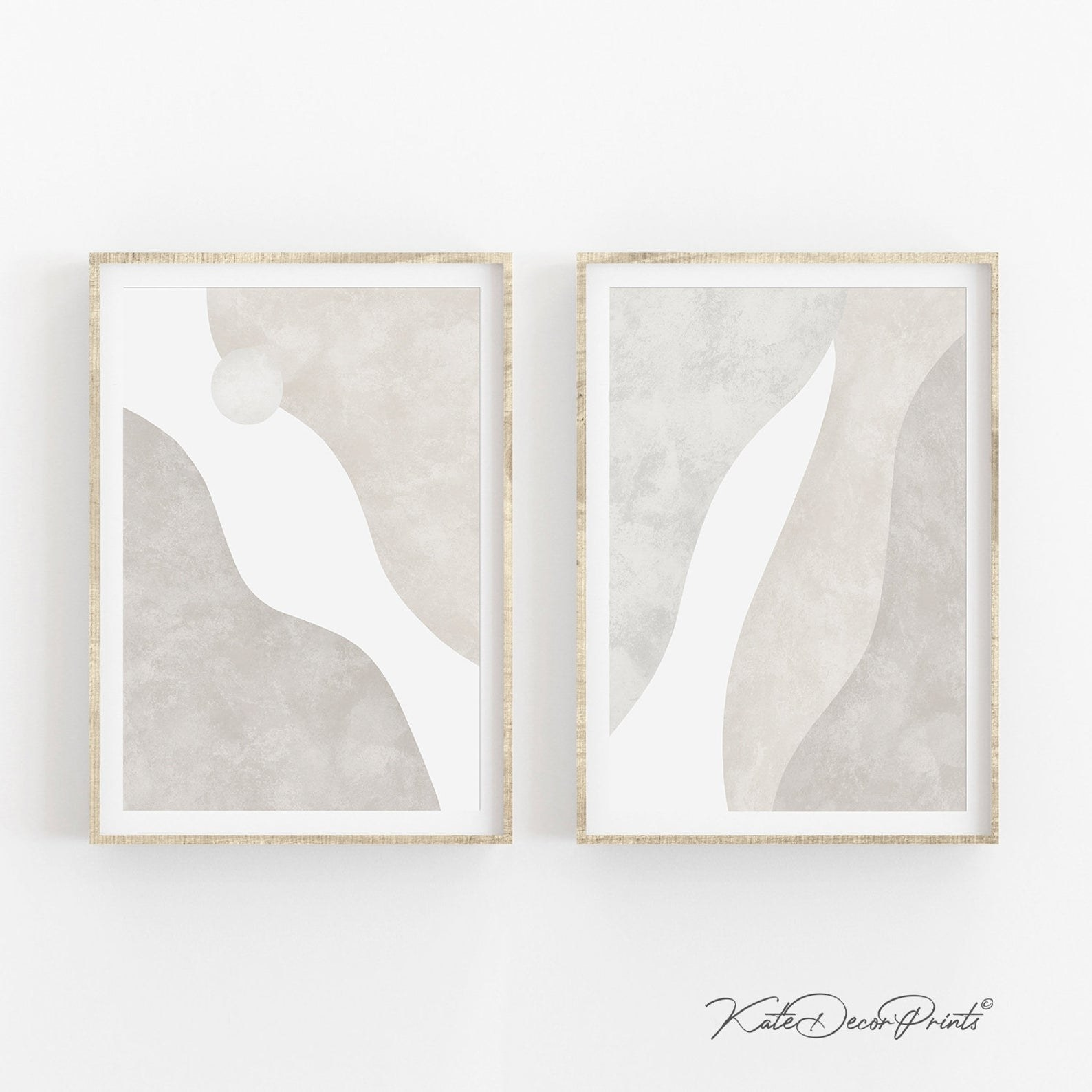 Two gray and beige tone abstract art pieces hung up next to each other on a wall