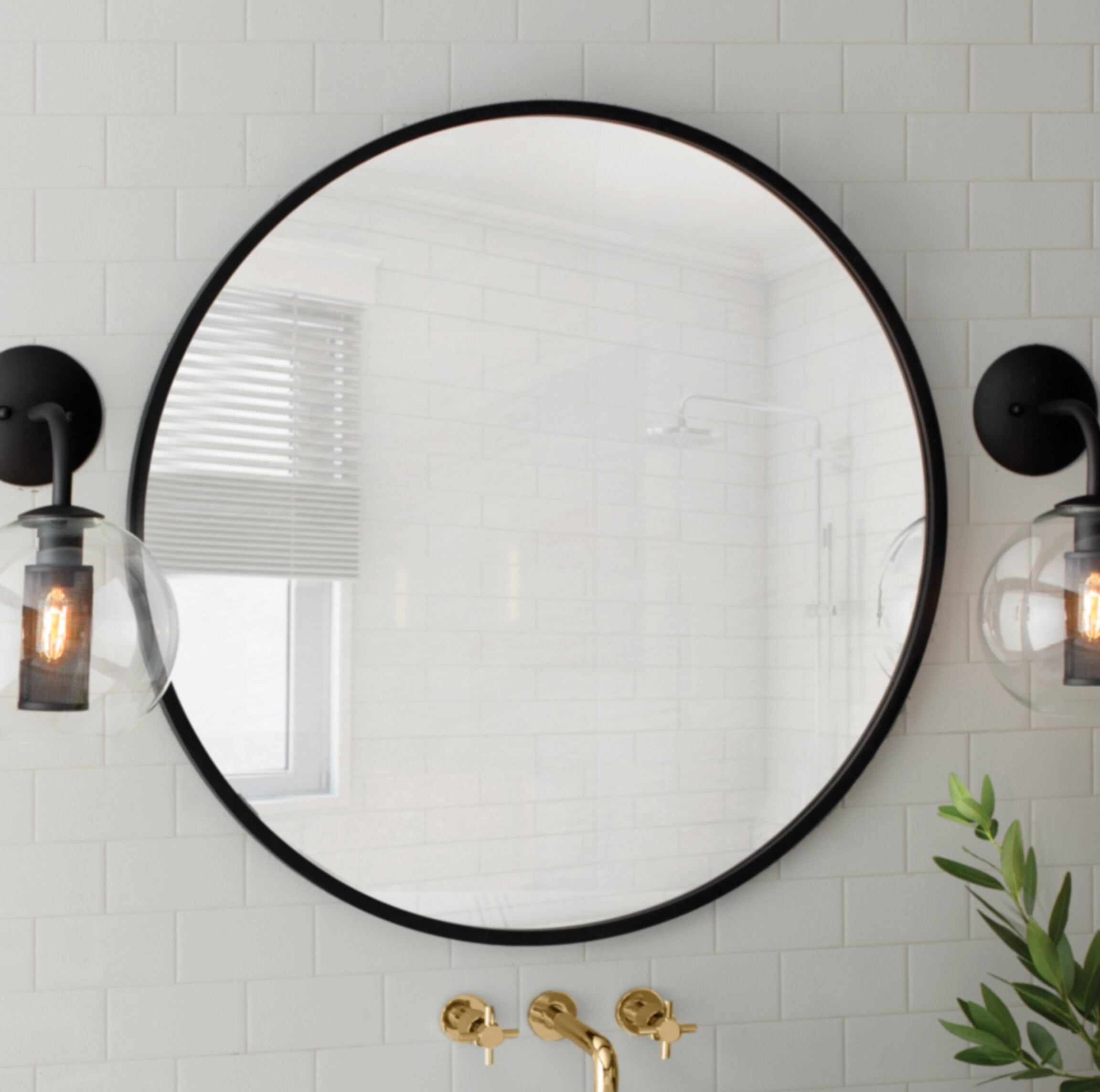 A black-rimmed round mirror on a wall