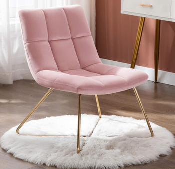 Pink accent chair over area rug