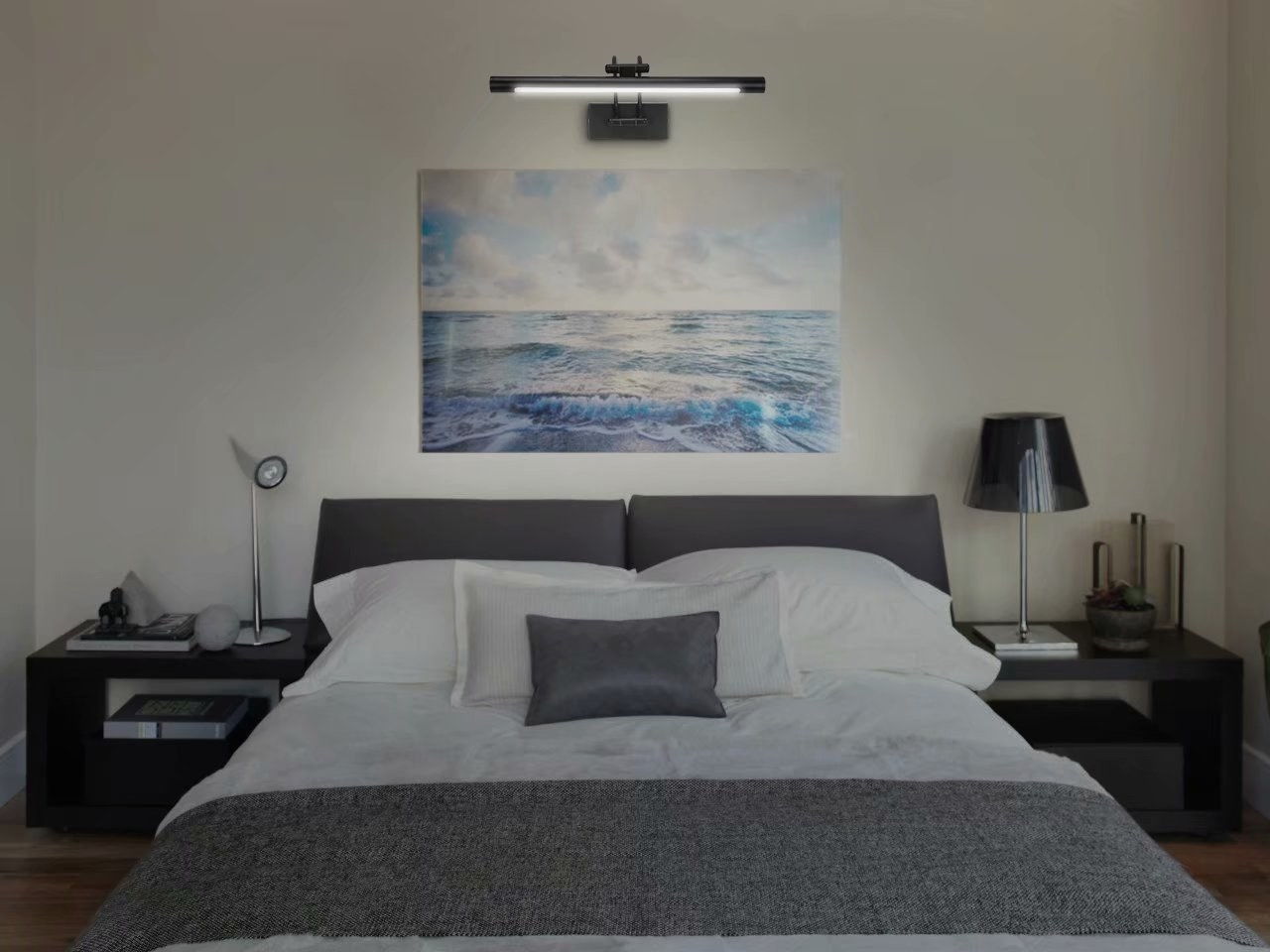 The LED above an ocean picture hanging above a bed