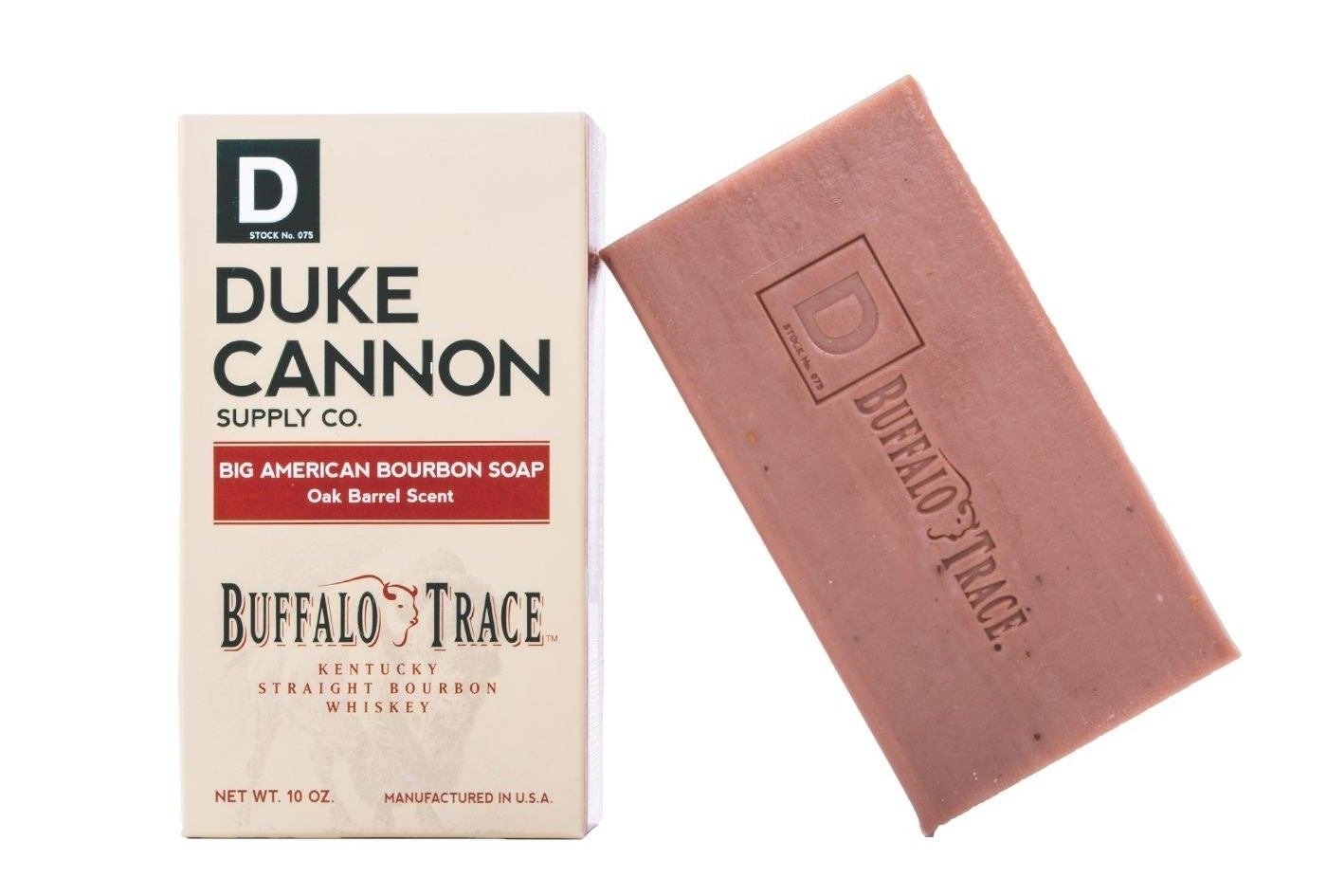 The soap, which is a light brown color and in the form of a rectangular bar