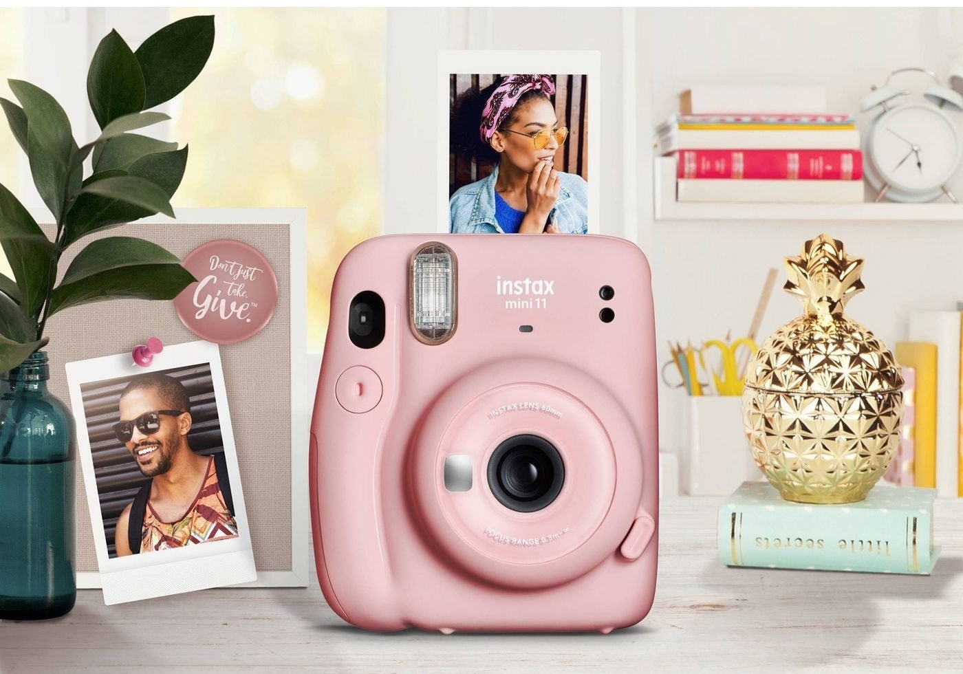 The camera, which is compact and has a built-in flash, in pink