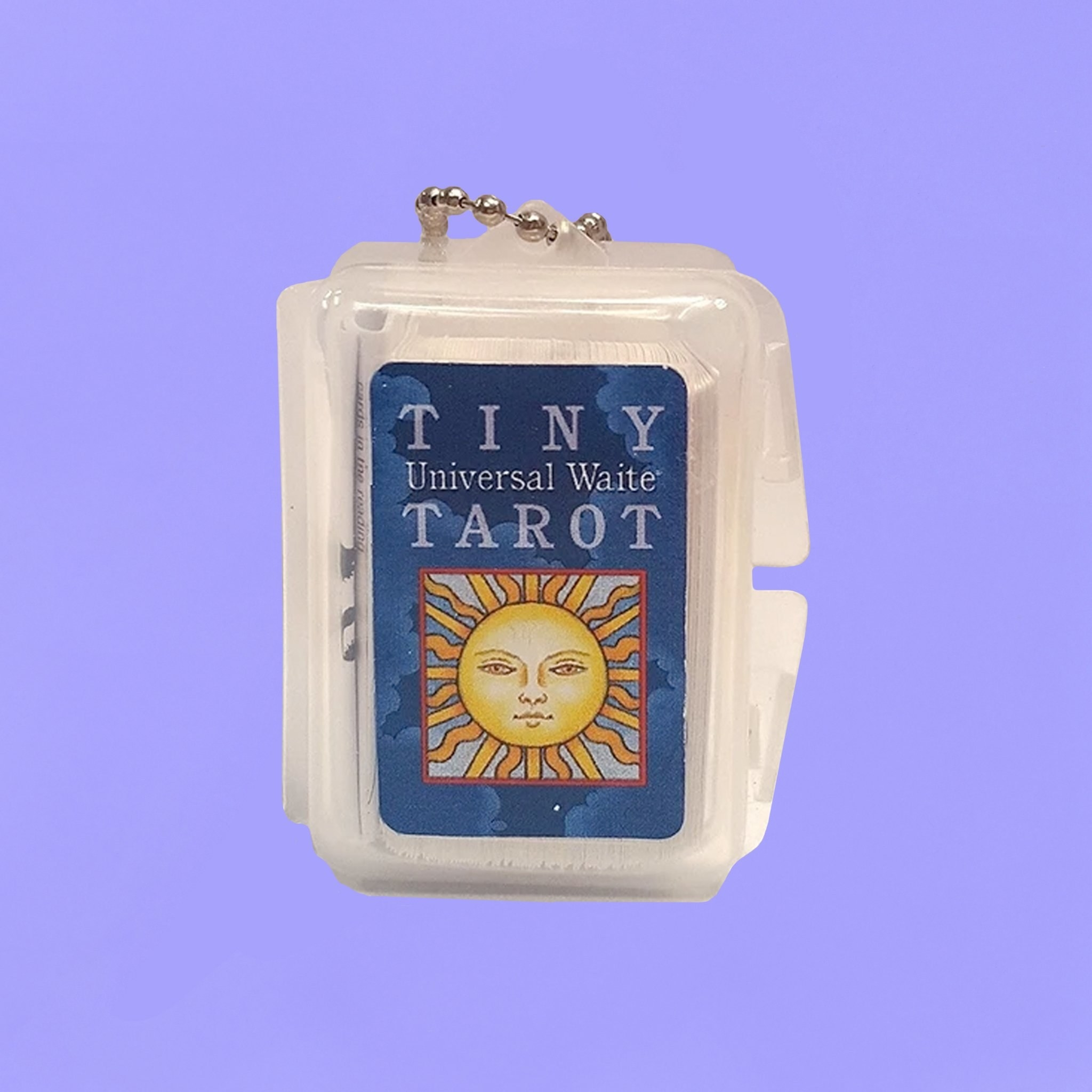The tiny taro cards in their container which is attached to a keychain