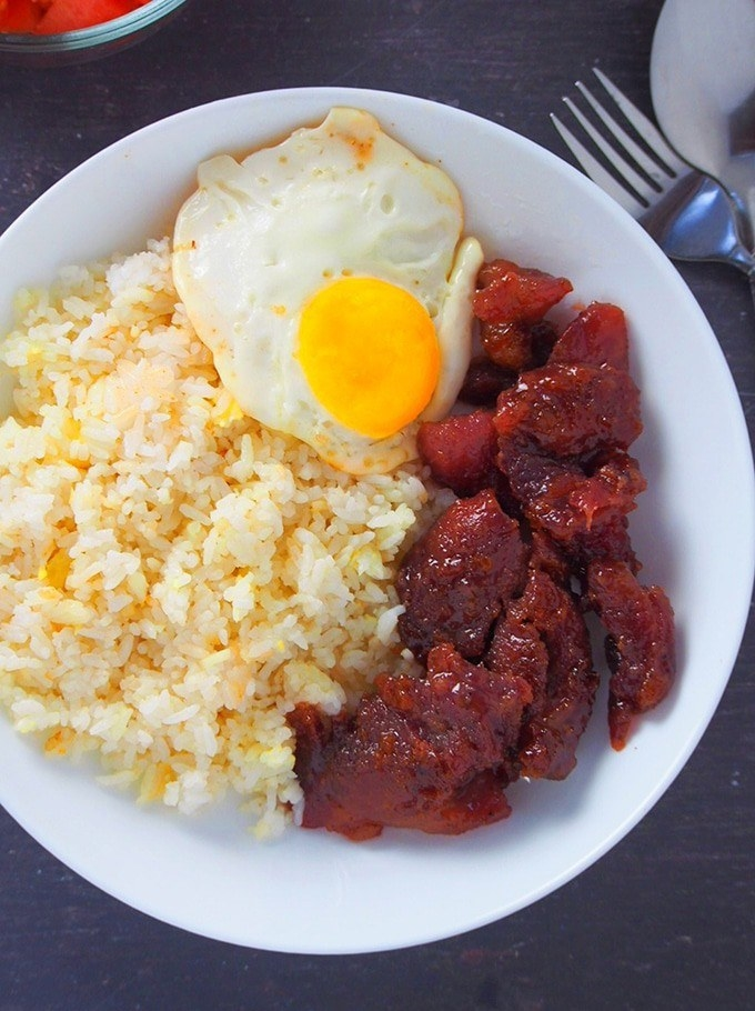 Tocino plated with rice and a fried egg