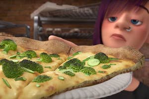 "The teenager from ""Inside Out"" holding pizza topped with broccoli"