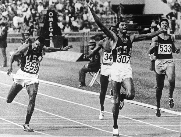 Tommie Smith celebrating while winning race