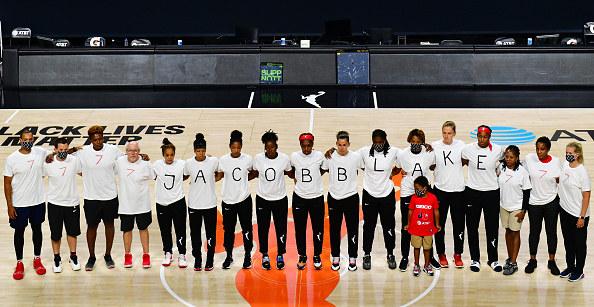 WNBA players in Jacob Blake shirts