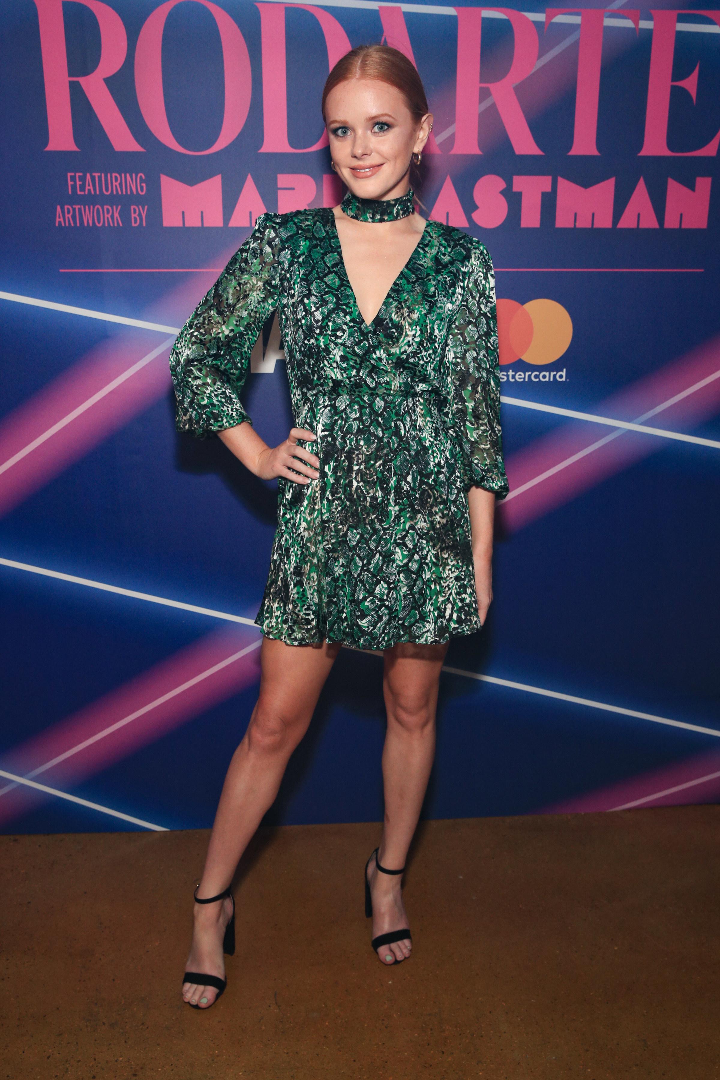 Abigail Cowen in a green dress