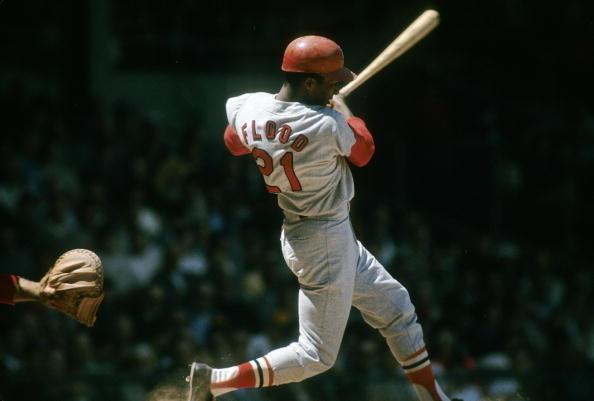 Curt Flood swinging a bat