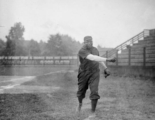 Rube Foster practicing on baseball field