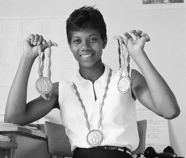 Wilma Rudolph holding medals