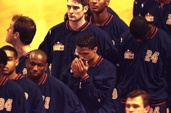 Mahmoud Abdul-Rauf praying during the national anthem