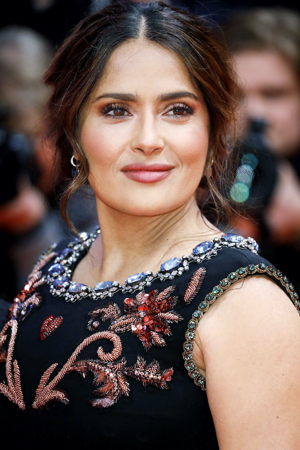Salma Hayek wears a dress with a jeweled collar for the premiere of The Roads Not Taken at the Berlin Film Festival