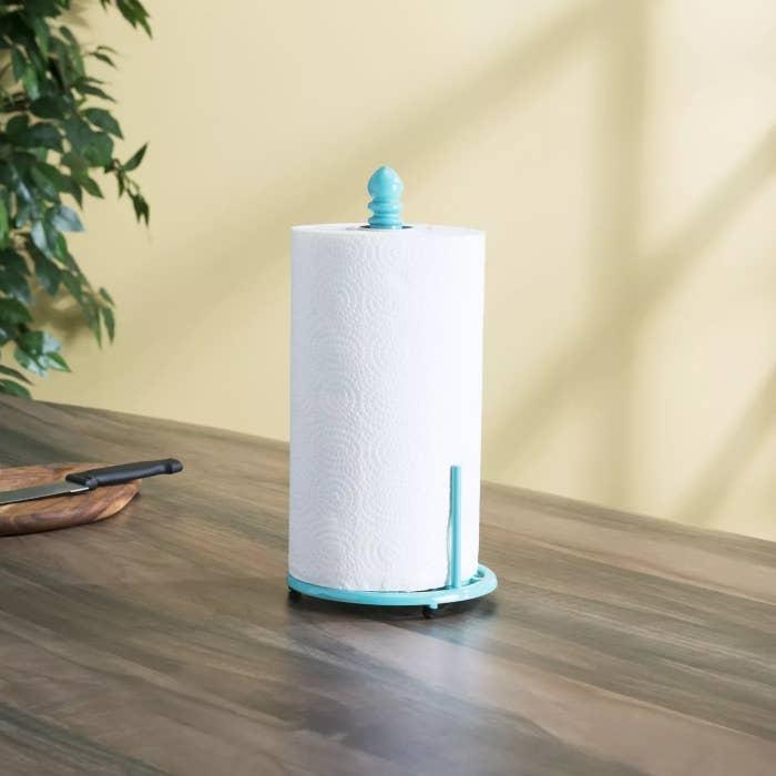 The teal towel holder