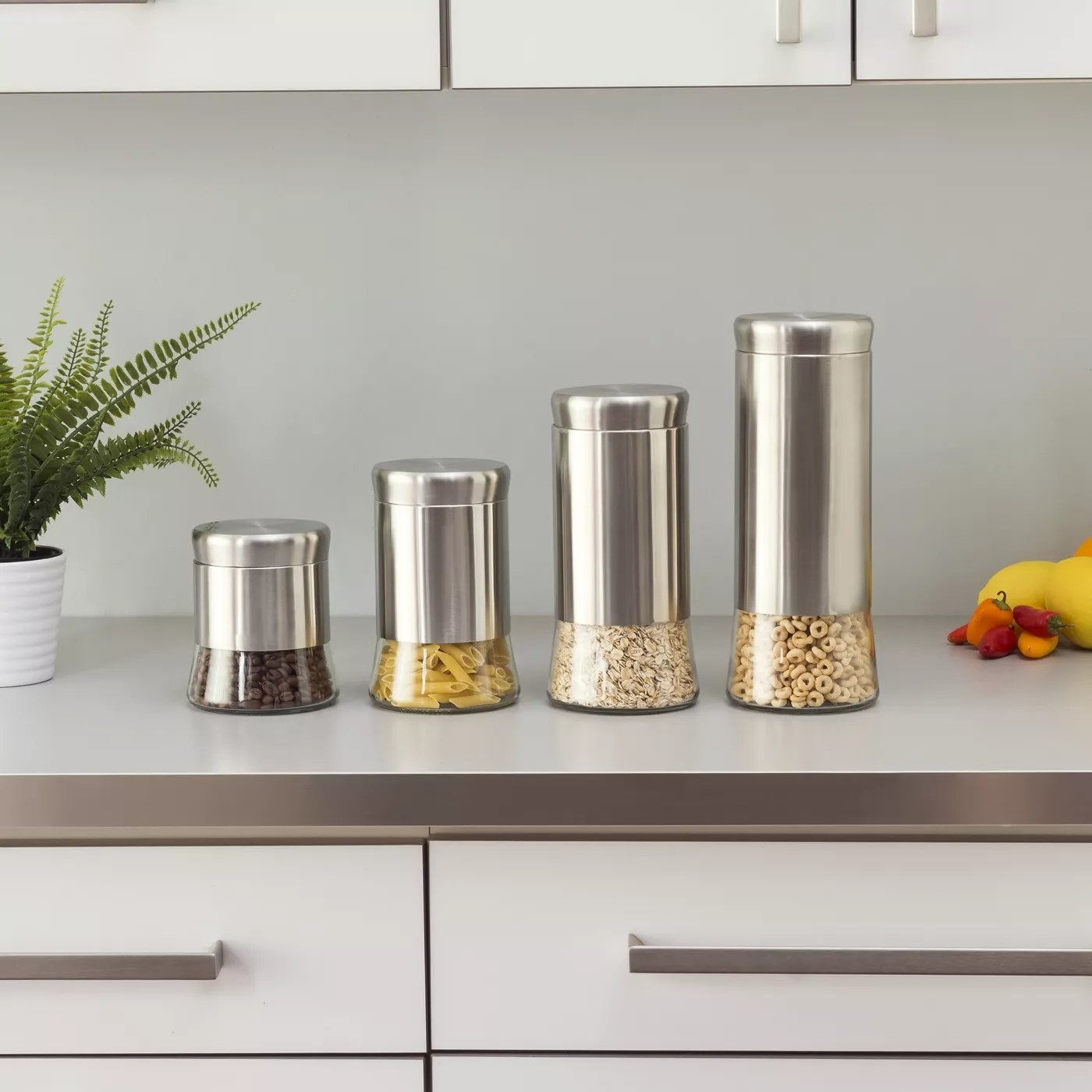 The four stainless steel canisters
