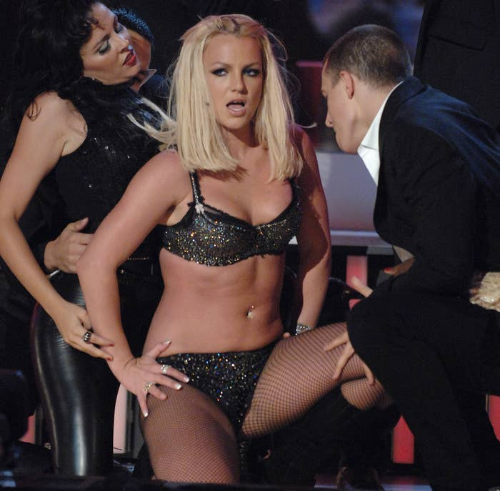 Britney performs in a sequined bra top and underwear paired with fishnet stockings