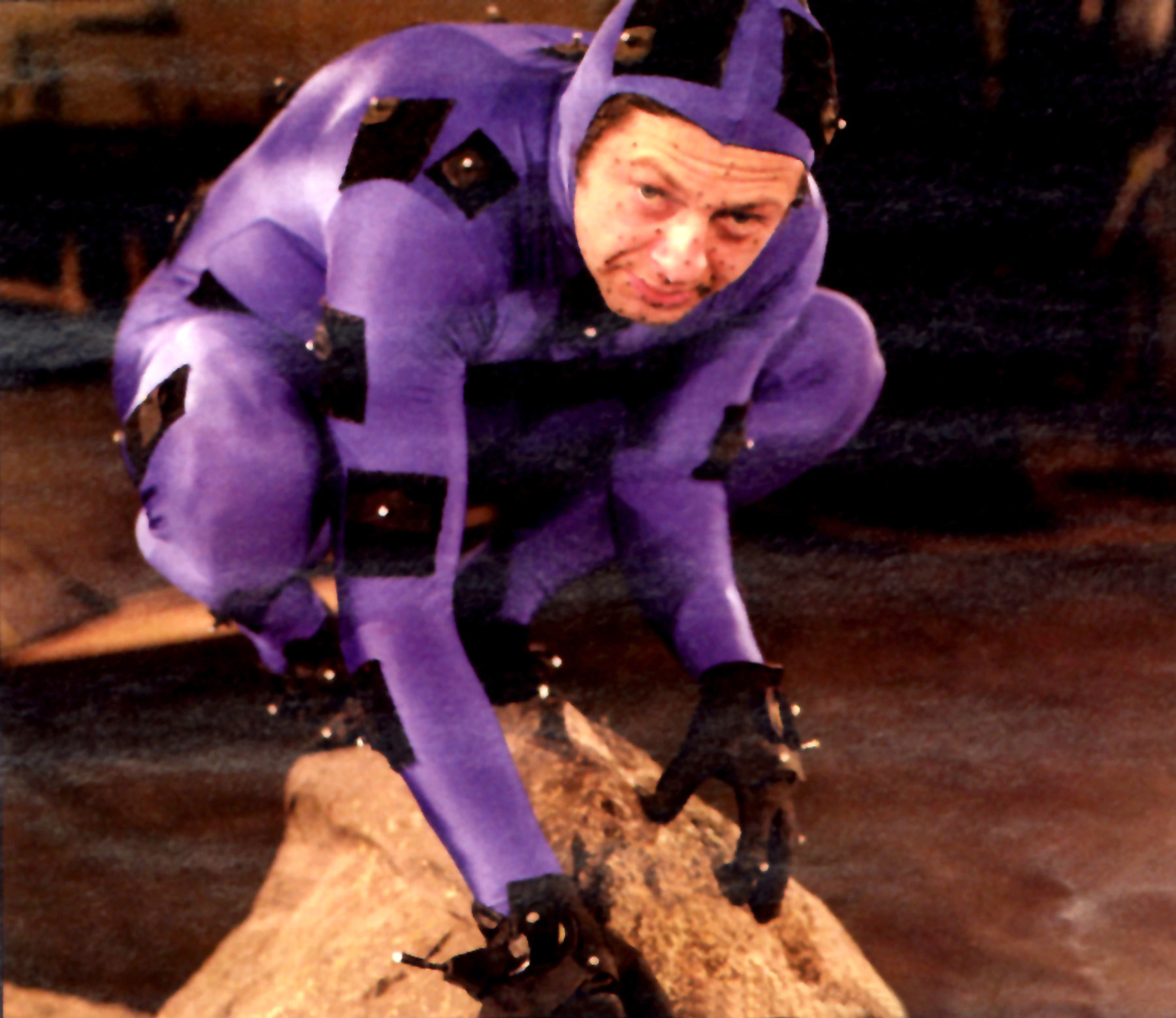 Andy Serkis crouching as Gollum in a morph suit