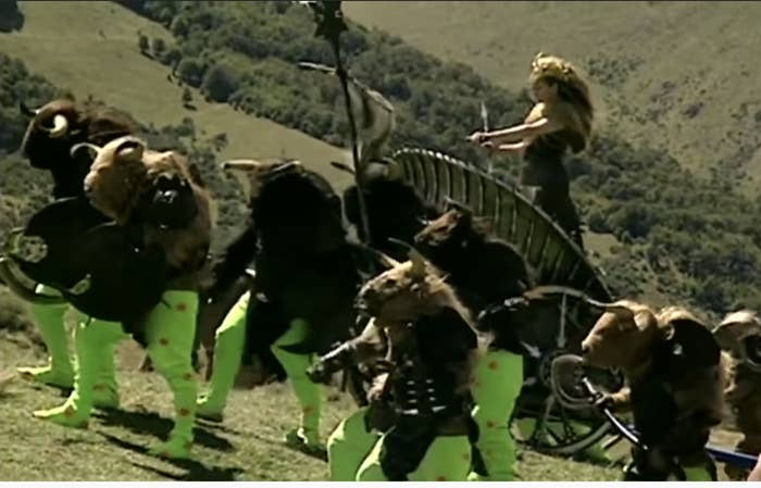 still from the first chronicles of Narnia with people with green tights and horned masks and furry tops