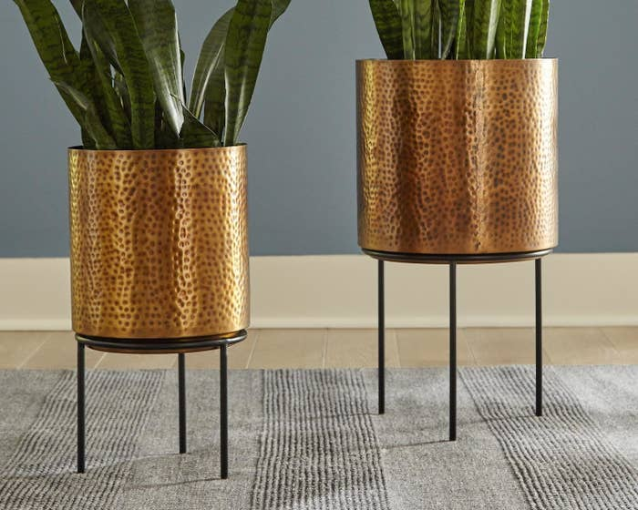 Two antique brass, hammered planters on stands