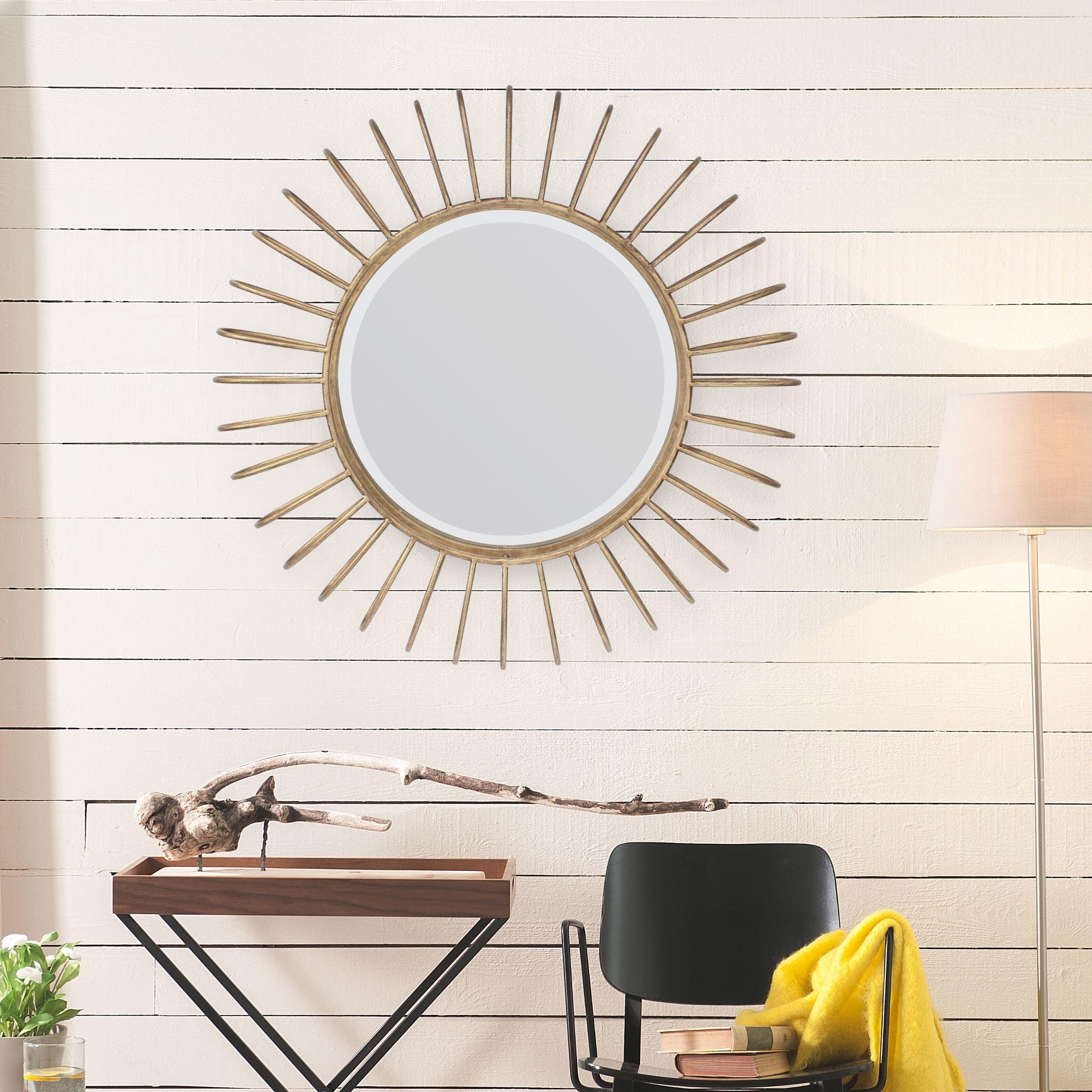 A gold sunburst mirror