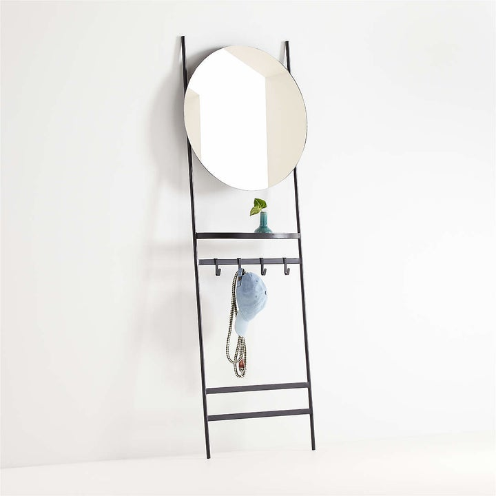ladder with round mirror on the top and hooks in the middle