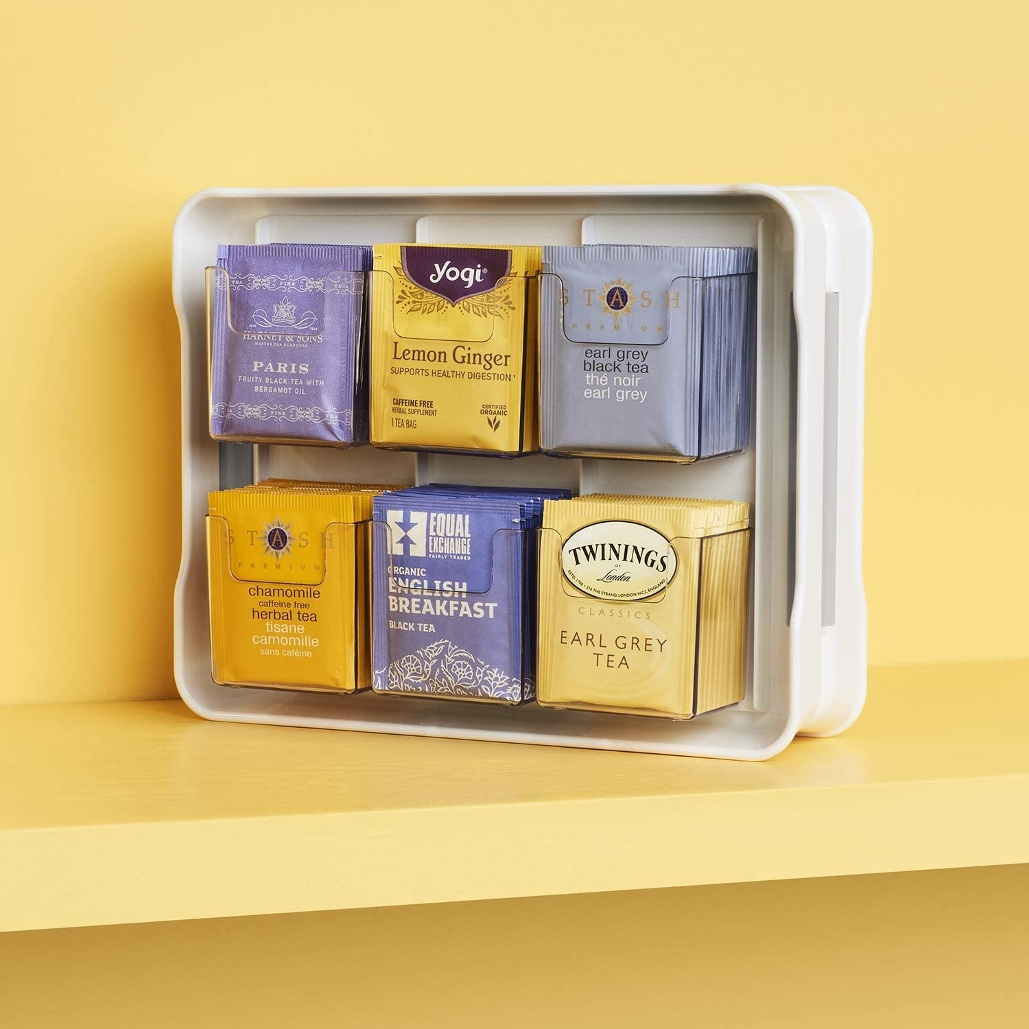 the tea stand filled with tea bags