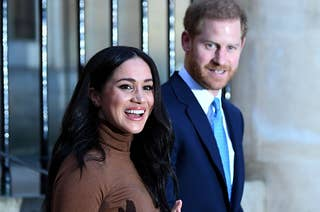 Meghan and Harry smile while on their way to an event