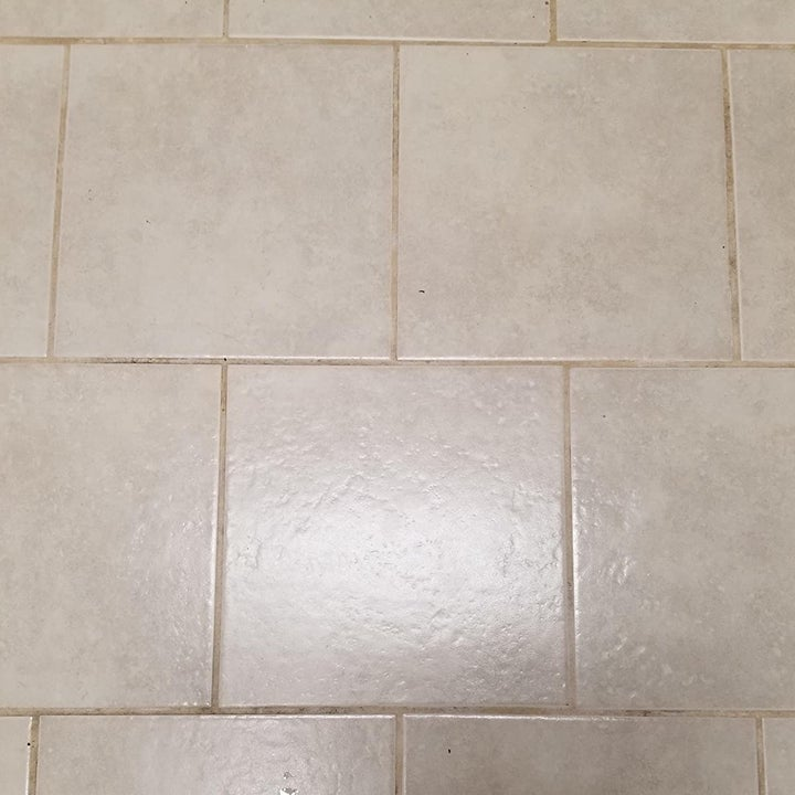 A reviewer photo of the same tile floor with the grout appearing significantly lighter