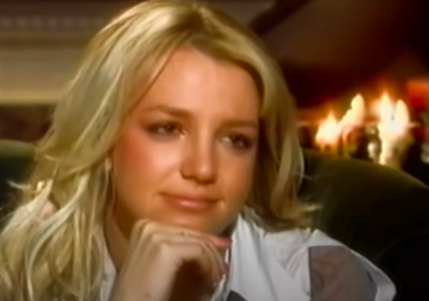 Britney with a look of disbelief on her face