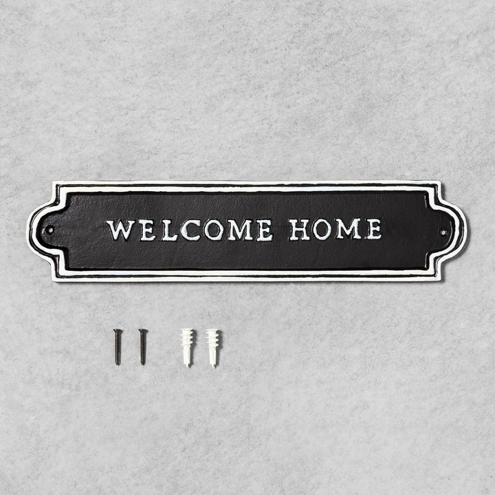 welcome home sign with two screws that come with it