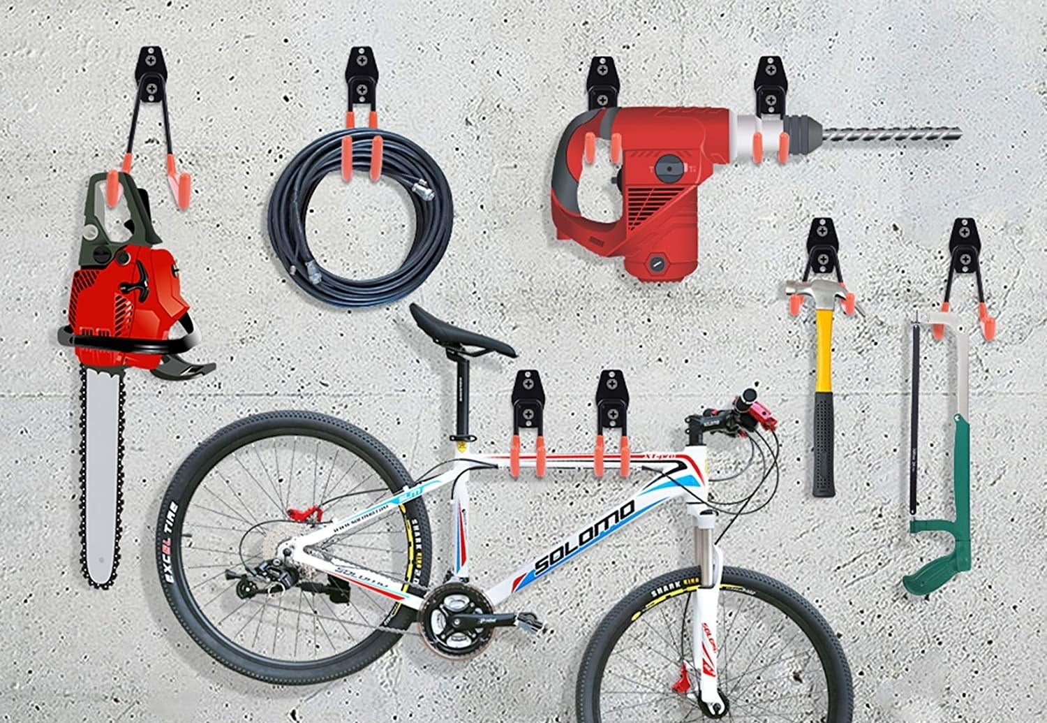 various tools and a bike hanging from the hooks