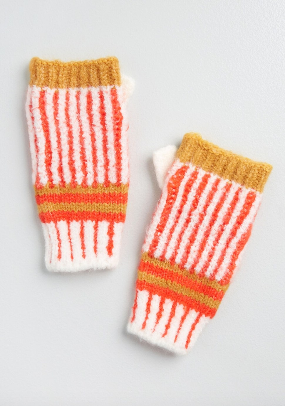 The pair of fingerless gloves in yellow, orange, and white