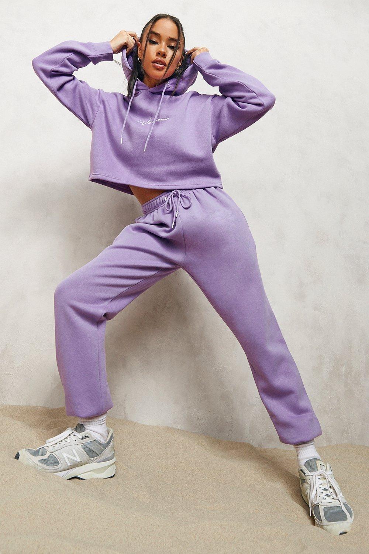 model wearing the purple joggers
