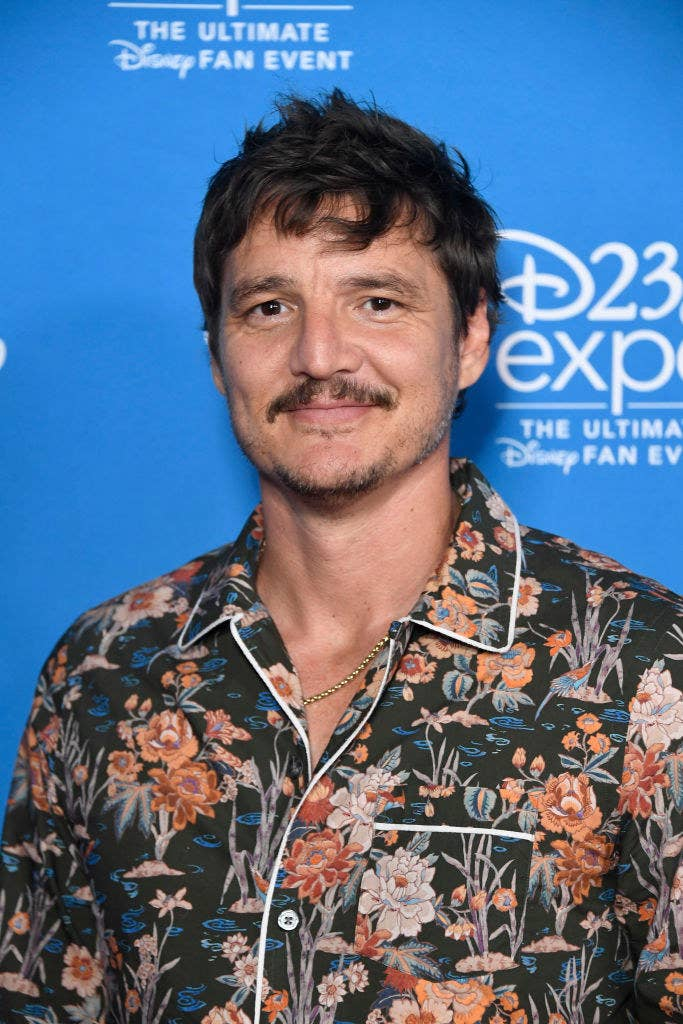 Pedro wearing a floral print shirt at an event