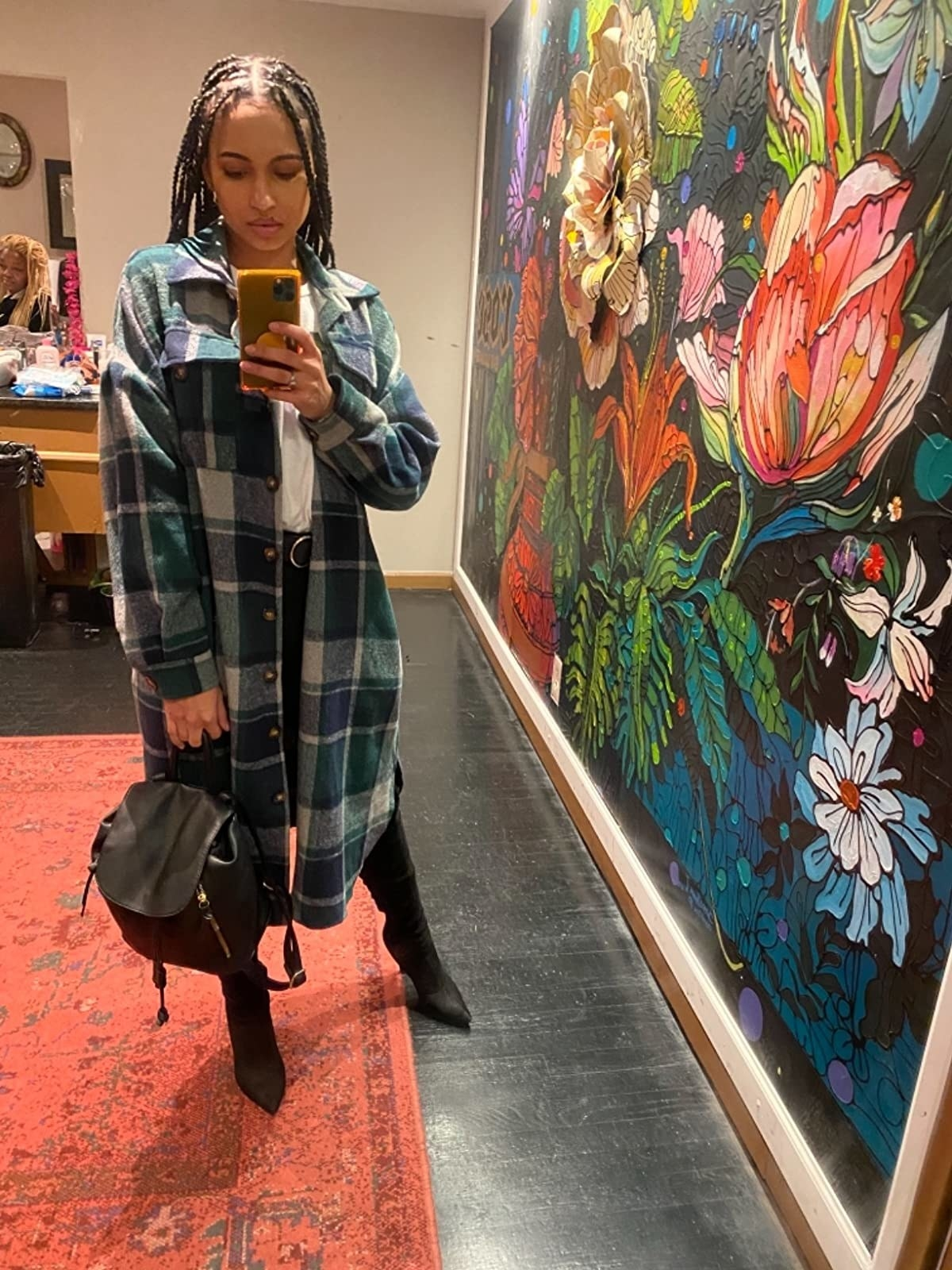 reviewer wearing the mid-calf length plaid jacket in blue and green