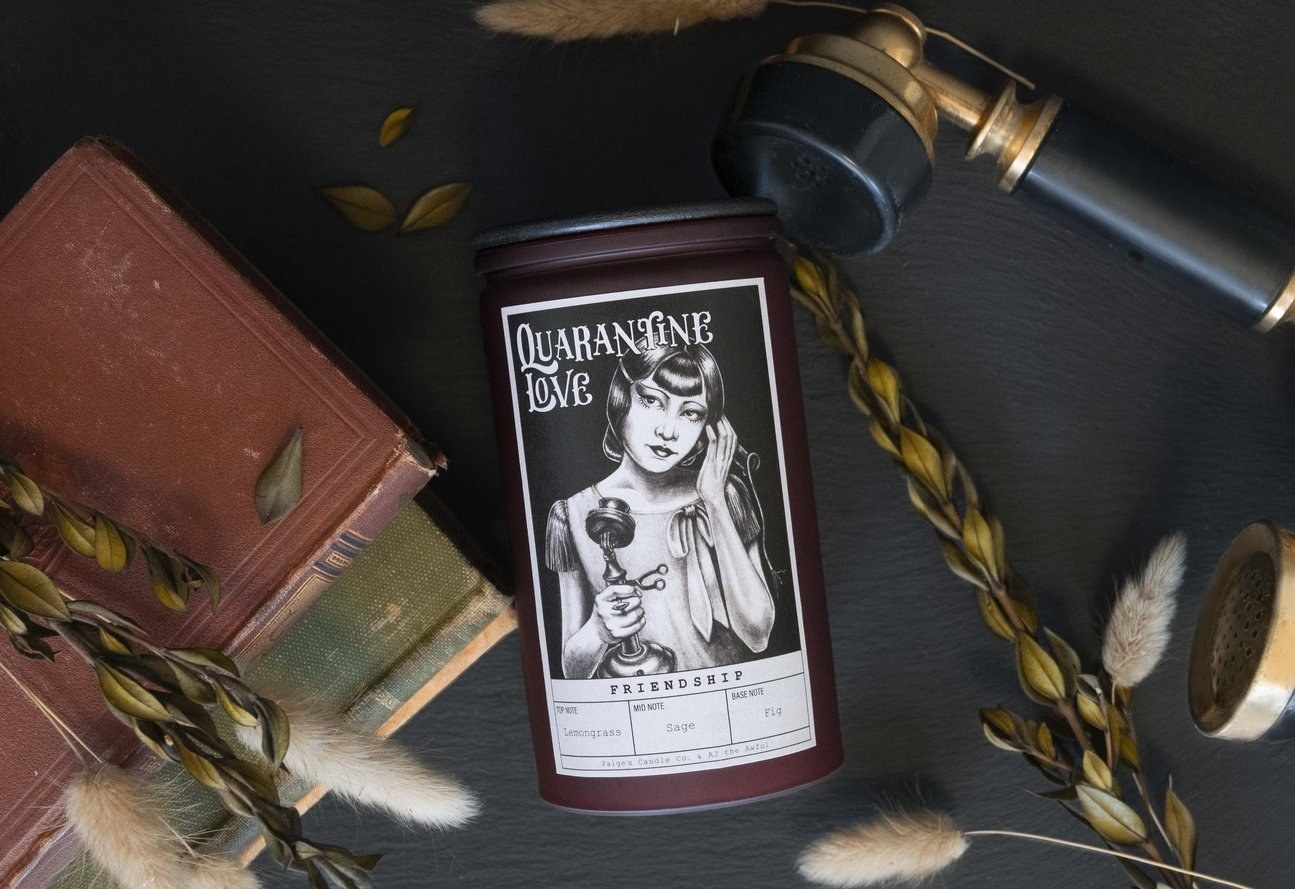 """tall jar candle with a black and white cartoon of a woman talking on a phone with """"Friendship Quarantine Love"""" on the candle"""