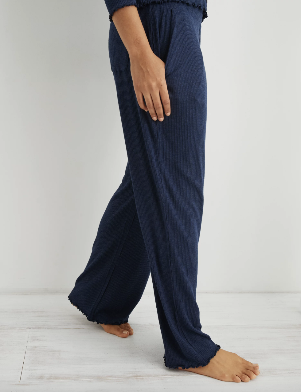 model wearing the wide leg navy sleep pants