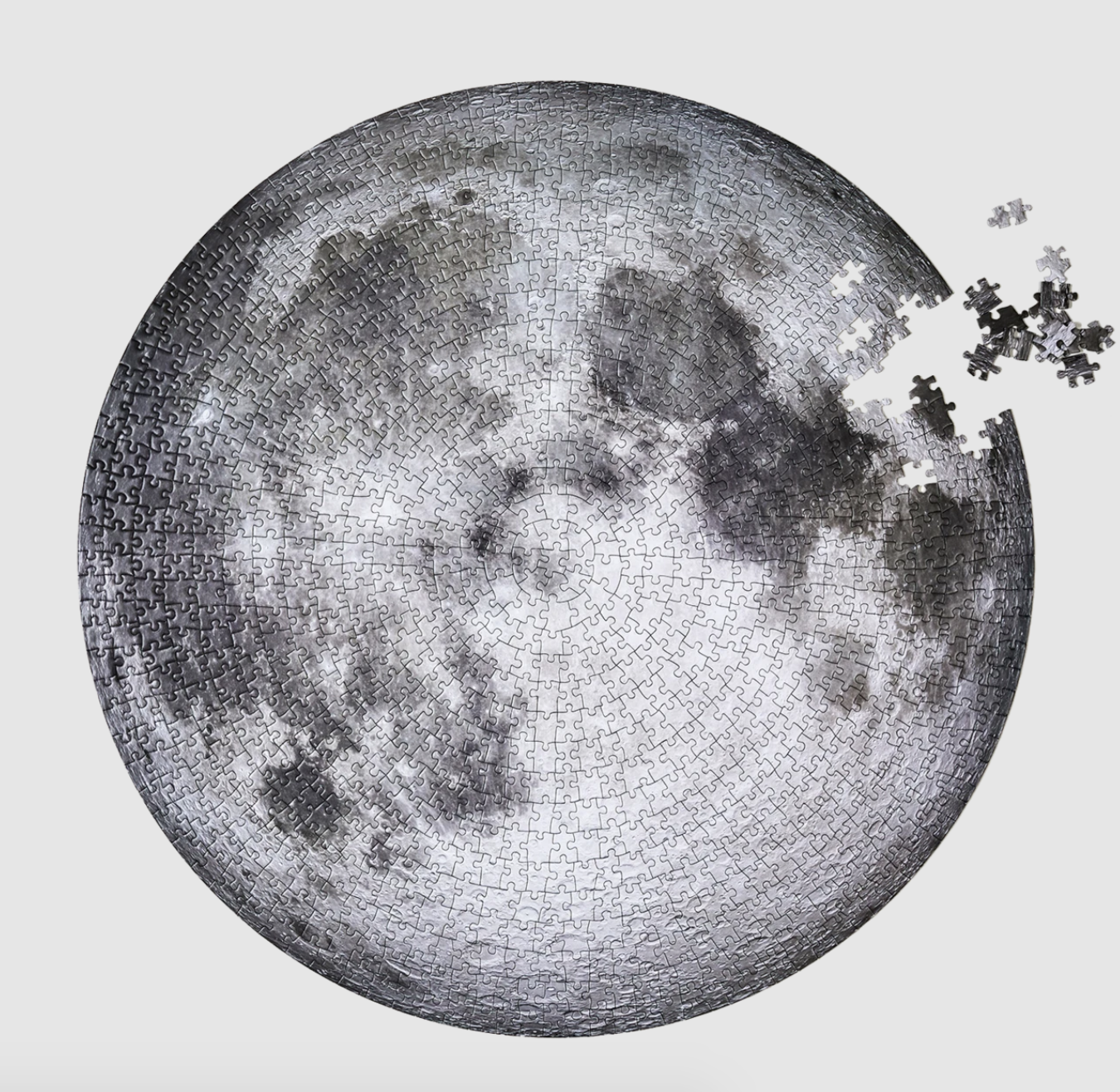 a circular black and white puzzle of the moon
