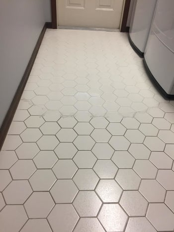 A reviewer photo of a tile floor with half the floor switch stained grout and the other half looking clean