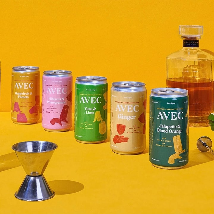 Five cans on orange background