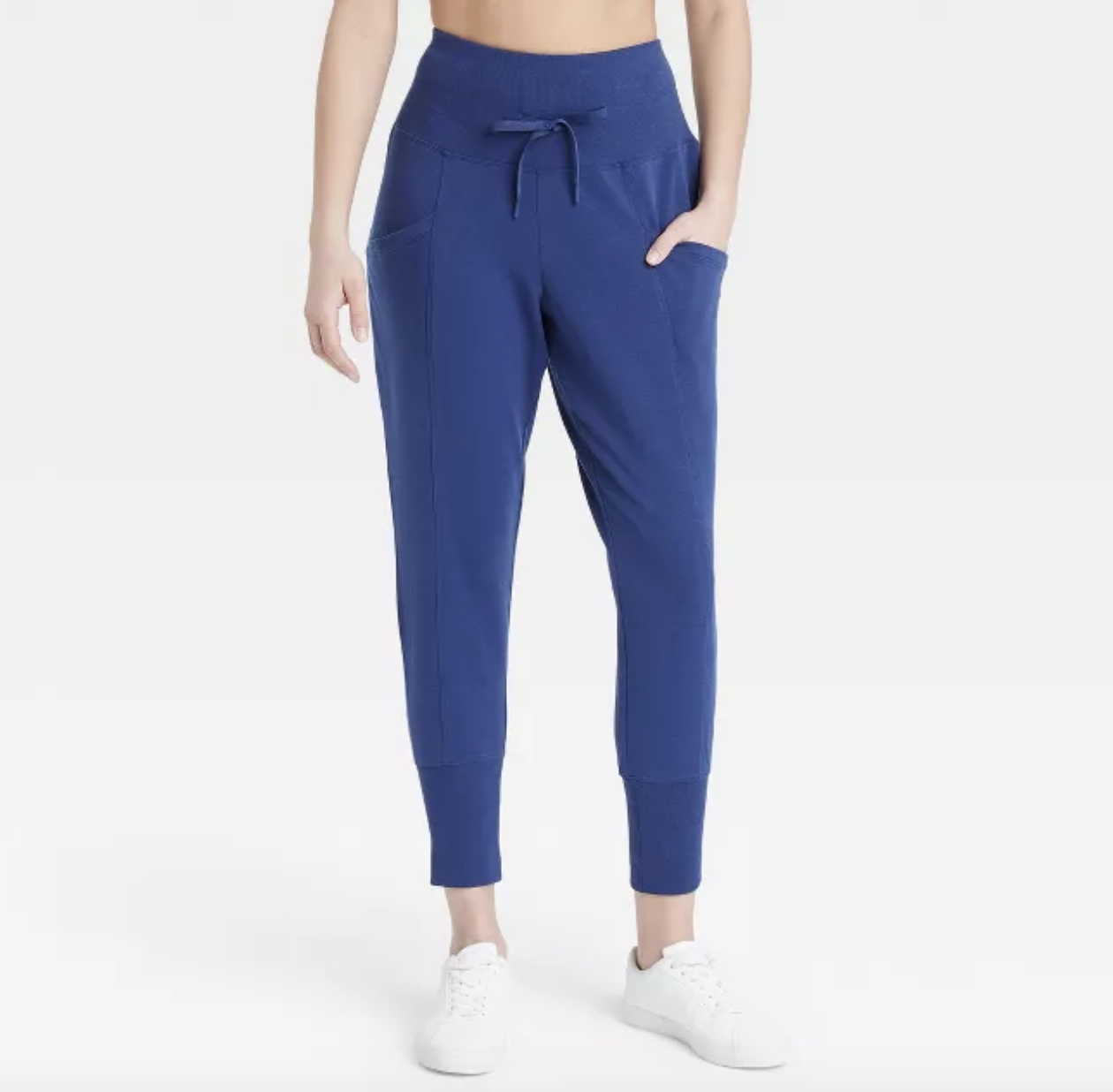 model wearing the royal blue high waisted joggers