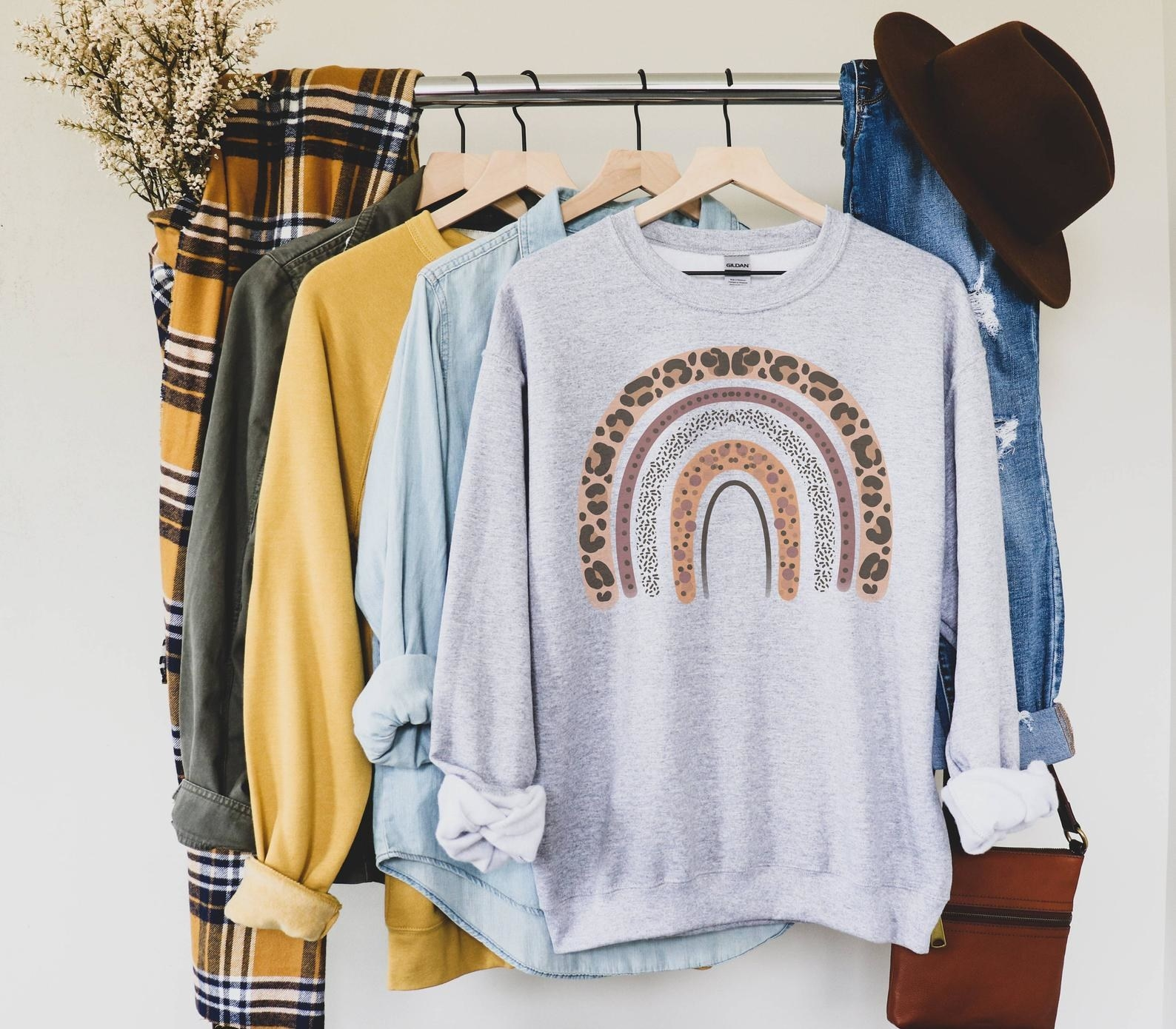 the gray sweater with a leopard rainbow graphic