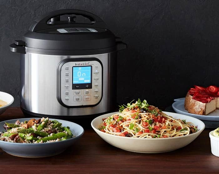 the instant pot next to various dishes of food
