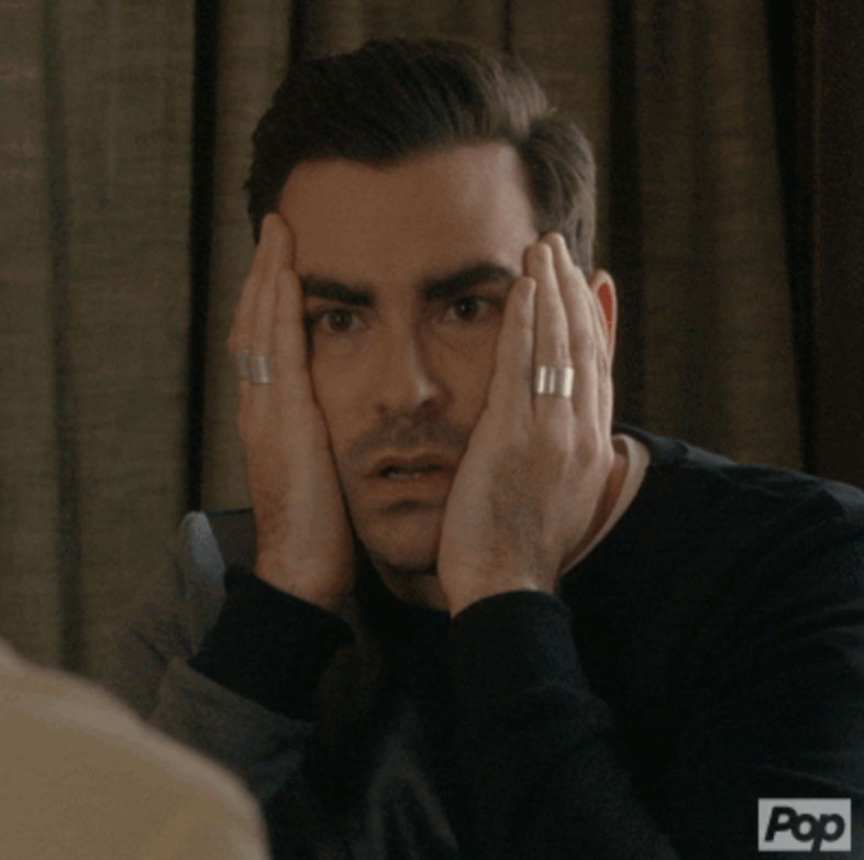 """David from """"Schitt's Creek"""" putting his hands on his face in disbelief"""